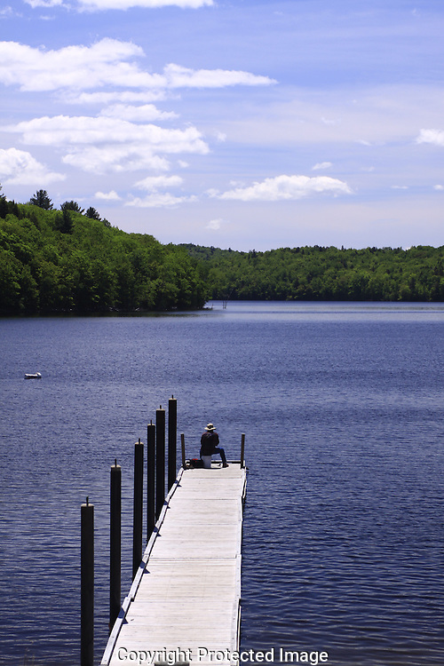 spring therapy, harriman reservoir, Wilmington,VT,blue water,white clouds, blue sky, dock, fisherman