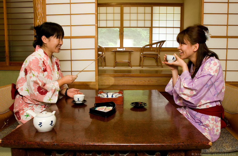 Hayashi Yuko (L) and Kojima Kiyoko (R), wearing yukata and drinking tea in their room inside the 82 years old Ryokan (traditional Japanese hotel) of the Takaragawa onsen (hot spring) in Gunma prefecture north of Tokyo - JAPAN 8 July 2006