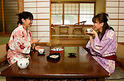 Hayashi Yuko (L) and Kojima Kiyoko (R), wearing yukata and drinking tea in their room inside the 82 years old Ryokan (traditional Japanese hotel) of the Takaragawa onsen (hot spring) in Gunma prefecture north of Tokyo - JAPAN 8 July 2006