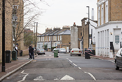 © Licensed to London News Pictures. 04/04/2016. London, UK. Police  car and police officers at the cordon in Camplin Street, New Cross, Lewisham, where a 17 year old boy died last night after being fatally stabbed. Police have arrested two teens in connection with the murder. Photo credit : Vickie Flores/LNP