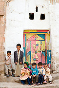 Yemen. Children at entrance to a home.