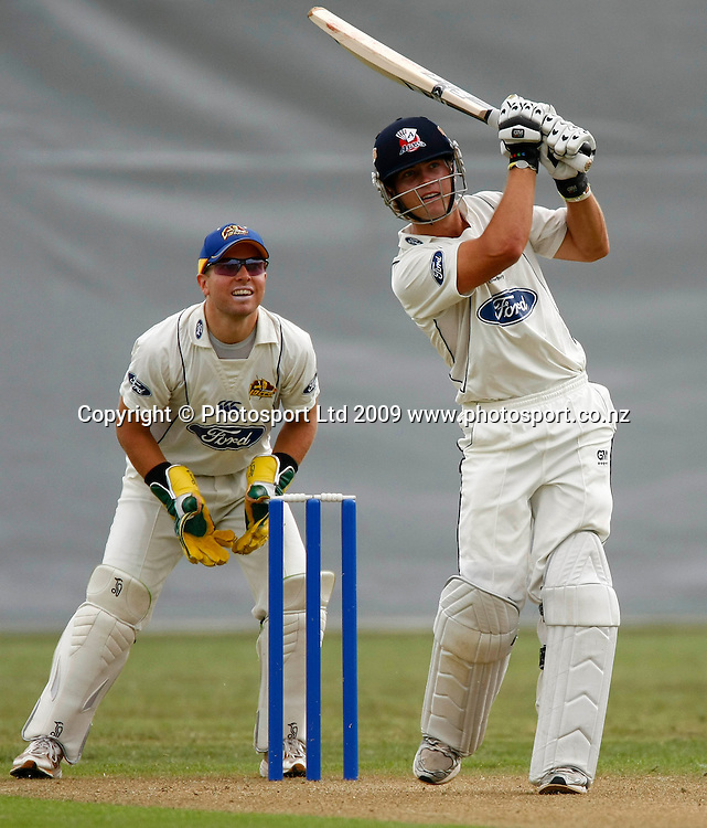 Auckland batsman Andrew De Boorder hits a boundary as his brother Otago keeper Derek De Boorder looks on. Auckland Aces v Otago Volts. Plunket Shield 4 Day, Colin Maiden Park, Auckland. Saturday 12 December 2009. Photo: Simon Watts/PHOTOSPORT