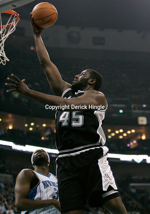 Mar 01, 2010; New Orleans, LA, USA; San Antonio Spurs forward DeJuan Blair (45) shoots over New Orleans Hornets forward Julian Wright (32) during the first half at the New Orleans Arena. Mandatory Credit: Derick E. Hingle-US PRESSWIRE