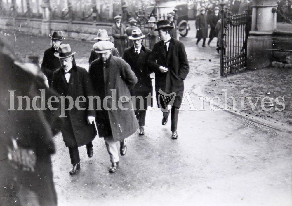 TDs arrive at Earlsfort Terrace for the debate on the ratification of the Anglo-Irish Treaty, Dec 1921-Jan 1922. Eamon Duggan is picture at the front to the left; a 1916 veteran and a senior member of both the IRB and IRA, Duggan was a solicitor by profession and had been a member of the Irish delegation that negotiated the treaty, which he supported. He had been elected Sinn F&eacute;in MP for Meath in 1918, and was subsequently a TD for Meath and Louth. <br /> (Part of the Independent Newspapers Ireland/NLI Collection)