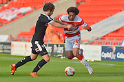 Sam Winnall of Barnsley FC and Keshi Anderson of Doncaster Rovers during the Sky Bet League 1 match between Doncaster Rovers and Barnsley at the Keepmoat Stadium, Doncaster, England on 3 October 2015. Photo by Ian Lyall.