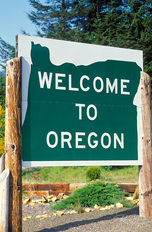 """""""Welcome to Oregon"""" sign at the California border in Brookings, Oregon"""
