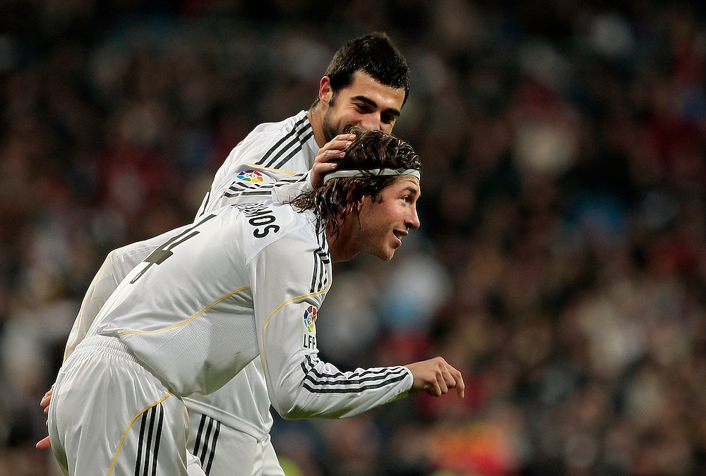Real Madrid's Sergio Ramos, right,  reacts after scoring against Espanyol with Raul Albiol, left, during a Spanish La Liga soccer match at the Santiago Bernabeu stadium in Madrid, , Saturday, Feb. 6, 2010.