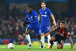 December 20, 2017 - London, England, United Kingdom - Chelsea Midfielder Tiemoue Bakayoko gets away from Bournemouth's Jordon Ibe during the Carabao Cup Quarter - Final match between Chelsea and AFC Bournemouth at Stamford Bridge, London, England on 20 Dec 2017. (Credit Image: © Kieran Galvin/NurPhoto via ZUMA Press)