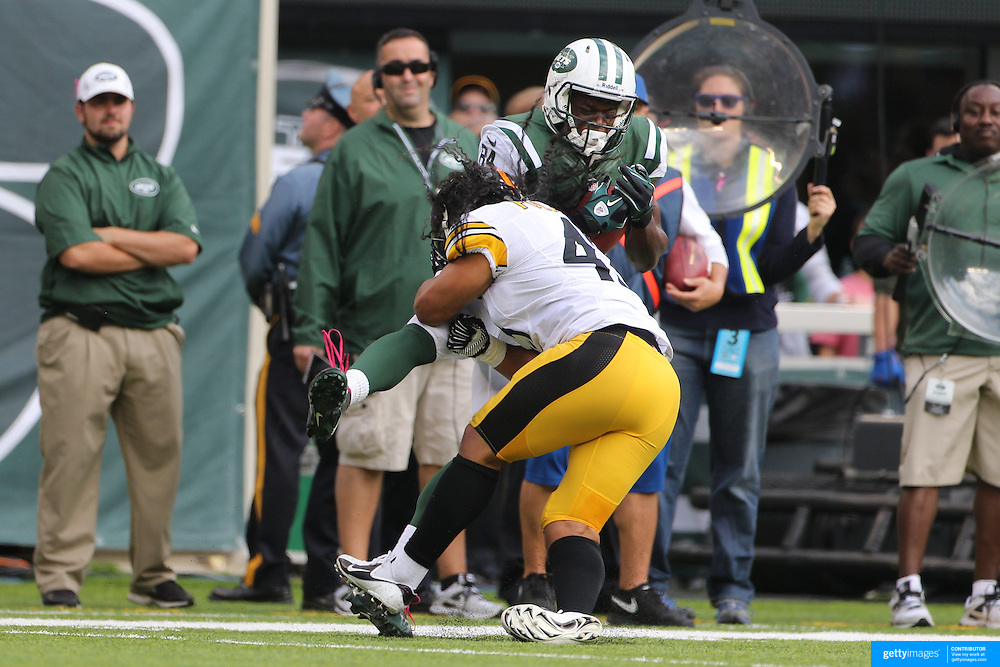 Stephen Hill, New York Jets, is hit after catching the ball by Troy Polamalu, Pittsburgh Steelers,  during the New York Jets V Pittsburgh Steelers NFL regular season game at MetLife Stadium, East Rutherford, NJ, USA. 13th October 2013. Photo Tim Clayton