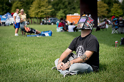 August 21, 2017 - Louisville, Kentucky, U.S. - A man, who declined to offer his name, uses a welders mask to look at the sun during a solar eclipse. (Credit Image: © Bryan Woolston via ZUMA Wire)