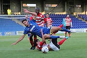 Ryan Sweeney fouled during the Friendly match between Kingstonian and AFC Wimbledon at the Cherry Red Records Stadium, Kingston, England on 30 July 2015. Photo by Stuart Butcher.