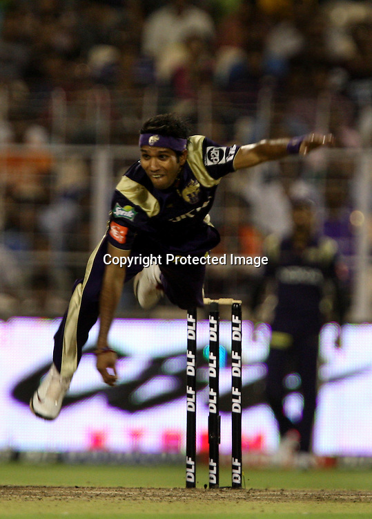 Kolkata Knight Riders Bowler Ashok DInda In Bowling Action Against Mumbai Indians During The  Indian Premier League - 56th match Twenty20 match | 2009/10 season Played at Eden Gardens, Kolkata 19 April 2010 - day/night (20-over match)