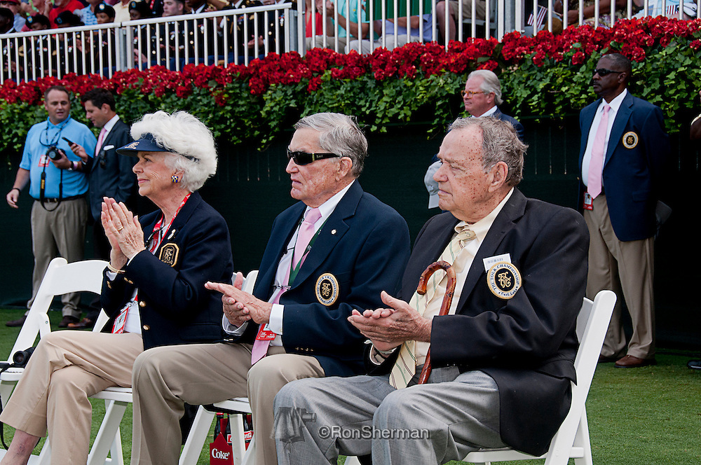 Ann and Tom Cousins (left, center) with Dan Yates, who has attended every Masters Tournament since 1934.