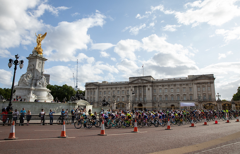 Riders racing along past The Queen Victoria Memorial and Buckingham Palace. The Prudential RideLondon Classique. Saturday 28th July 2018<br /> <br /> Photo: Ian Walton for Prudential RideLondon<br /> <br /> Prudential RideLondon is the world's greatest festival of cycling, involving 100,000+ cyclists - from Olympic champions to a free family fun ride - riding in events over closed roads in London and Surrey over the weekend of 28th and 29th July 2018<br /> <br /> See www.PrudentialRideLondon.co.uk for more.<br /> <br /> For further information: media@londonmarathonevents.co.uk