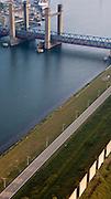 Nederland, Zuid-Holland, Rotterdam, 19-09-2009; Rozenburg, windschermen langs het Calandkanaal zorgen er voor dat hoog geladen containerschepen bij harde  wind niet afdrijven en veilig de nabijgelegen Calandbrug kunnen passeren..Rozenburg, wind barriers along the Calandkanaal ensure that loaded container ships do not drift with high winds and ensure safe passage of the Caland Bridge.luchtfoto (toeslag), aerial photo (additional fee required).foto/photo Siebe Swart