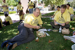 Palo Alto, CALIF. June 24, 2004--Tech worker's Art Whipple, L , and Steve Schultz both of QuickLogic , eat lunch  prior to a rally to protest changes to stock option regulations at the Palo Alto Civic Center Plaza in Palo Alto, Calif., Thursday, June 24, 2004. Photo by Kim Kulish