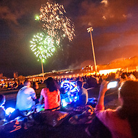 070413       Cable Hoover<br /> <br /> Spectators watch and record the fireworks show during the Fourth of July Stars and Stripes Celebration at the Gallup Sports Complex Thursday.