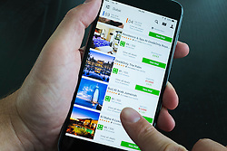 Luxury hotels in Dubai showing on Trivago hotel booking app on iPhone 6 Plus smart phone
