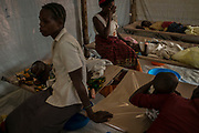 KYANGWALI REFUGEE CAMP, UGANDA - MARCH 23: Mothers wait with their children suffering from severe symptoms of cholera at a treatment center in Kyangwali refugee resettlement camp in Uganda on March 23, 2018. Cholera is endemic in Eastern Congo and many of the refugees bring the disease to the camp. Violence in Ituri Province in northeastern Democratic Republic of Congo has displaced more than 100,000 people including approximately 40,000 refugees who have fled to Uganda. (Photo by Andrew Renneisen for The Washington Post)