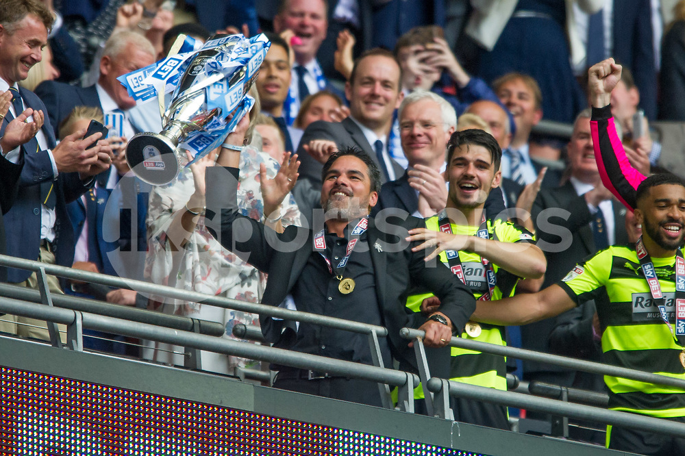 David Wagner manager of Huddersfield Town lifts the trophy to celebrate the promotion into the Premier League during the EFL Sky Bet Championship Play-Off Final match between Huddersfield Town and Reading at Wembley Stadium, London, England on 29 May 2017. Photo by Salvio Calabrese.