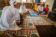 24 OCTOBER 2012 - PATTANI, PATTANI, THAILAND:  Men talk after afternoon prayers in Krue Se Mosque. More than 5,000 people have been killed and over 9,000 hurt in more than 11,000 incidents, or about 3.5 a day, in Thailand's three southernmost provinces and four districts of Songkhla since the insurgent violence erupted in January 2004, according to Deep South Watch, an independent research organization that monitors violence in Thailand's deep south region that borders Malaysia. Muslim extremists are battling the Thai government and its symbols, like schools and Buddhist facilities.    PHOTO BY JACK KURTZ