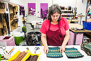 DEXTER, ME - AUGUST 4, 2015:  Corliss Fanjoy (63) an employee at Erda Handbags, works assembling bags at the company's production facility in Dexter, Maine. Since most of Erda's employees are 60 years or older they have implemented a flexible scheduling system and invested in more ergonomic machines to accommodate their aging workforce. <br /> Craig Dilger for The New York Times