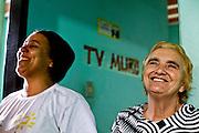 Sabara_MG, Brasil...A TV Muro e uma pequena organizacao produtora de televisao brasileira localizada na cidade de Sabara. E intitulada a menor rede de televisao do mundo. Na foto a esposa e a mae do criador da TV Francisco Dario dos Santos, o Chiquinho...The TV Muro is a small Brazilian television network, located in Sabara. Its the smallest TV in the world. Na foto the wife and the mother of the creator of tv Francisco Dario dos Santos, Chiquinho...Foto: JOAO MARCOS ROSA / NITRO