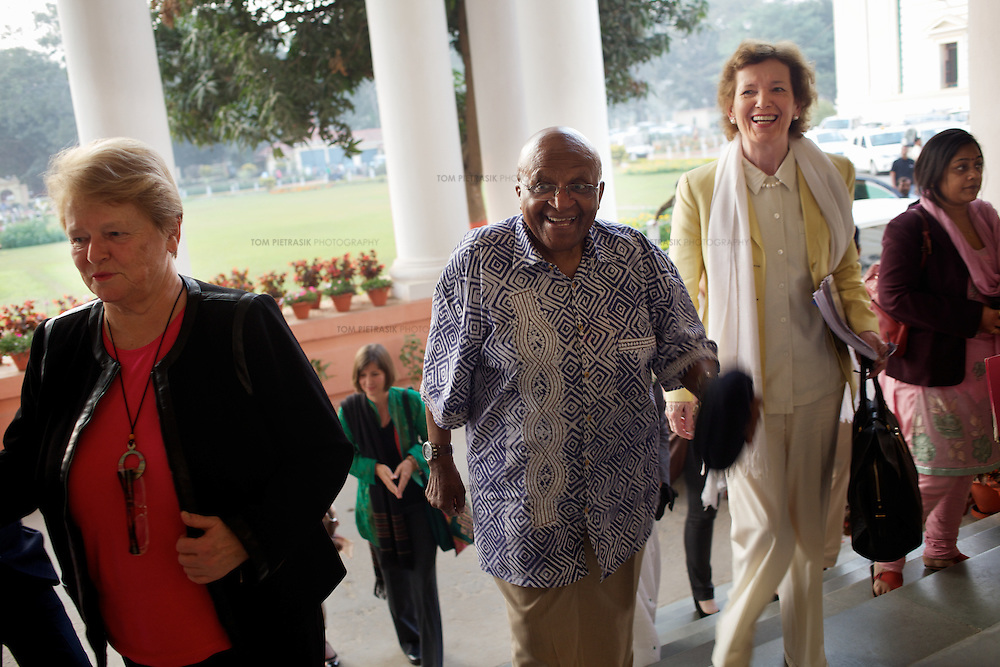 The Elders (LtoR: Gro Brundtland, Desmond Tutu & Mary Robinson; Ela Bhatt (not in photo also attended) arrive at the Bihar Chief Minister Nitish Kumar's office in Patna. The Elders met Nitish Kumar as part of the Girls Not Brides campaign.  ..The Elders are independent global leaders working together for peace and human rights. The group was founded by Nelson Mandela in 2007. Four of the The Elders,.Ela Bhatt, Mary Robinson, Desmond Tutu and Gro Brundtland spent a week in India. The primary objective of the their visit was to learn about the causes of child marriage in India, discuss the harmful impact of child marriage on human rights and development, and to encourage local efforts to end the practice. The Elders met political and business leaders, UN and NGO representatives, member of the media and communities affected by child marriage. ..Photo: Tom Pietrasik|The Elders.Patna, Bihar, India.February 7th 2012