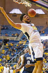 Nov 20, 2016; Morgantown, WV, USA; West Virginia Mountaineers forward Esa Ahmad (23) dunks the ball during the second half against the New Hampshire Wildcats at WVU Coliseum. Mandatory Credit: Ben Queen-USA TODAY Sports