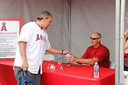 ANAHEIM, CA - APRIL 22:  Mike Witt, former member of the Los Angeles Angels of Anaheim, signs autographs at FanFest before the game against the Baltimore Orioles on Sunday, April 22, 2012 at Angel Stadium in Anaheim, California. The Orioles won the game 3-2 in ten innings. (Photo by Paul Spinelli/MLB Photos via Getty Images) *** Local Caption *** Mike Witt