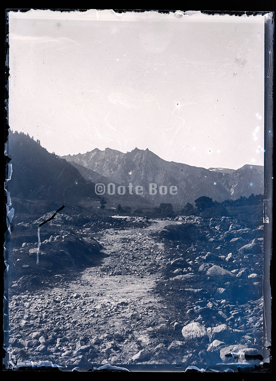 dry river bed with mountains Pyrenees ? France ca 1920s