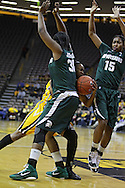 January 27 2010: Iowa guard Kachine Alexander (21) tries to drive between Michigan St. forward Lykendra Johnson (30) and Michigan St. forward Cetera Washington (15) during the first half of an NCAA women's college basketball game at Carver-Hawkeye Arena in Iowa City, Iowa on January 27, 2010. Iowa defeated Michigan State 66-64.