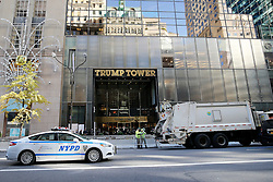 © Licensed to London News Pictures. 10/11/2016. New York CIty, USA. Trucks and concrete barriers used as extra security at the entrance to Trump Tower, the home of president-elect Donald Trump.  Protests have taken place outside Trump tower following a shock election victory by the controversial republican candidate earlier this week. Photo credit: Tolga Akmen/LNP