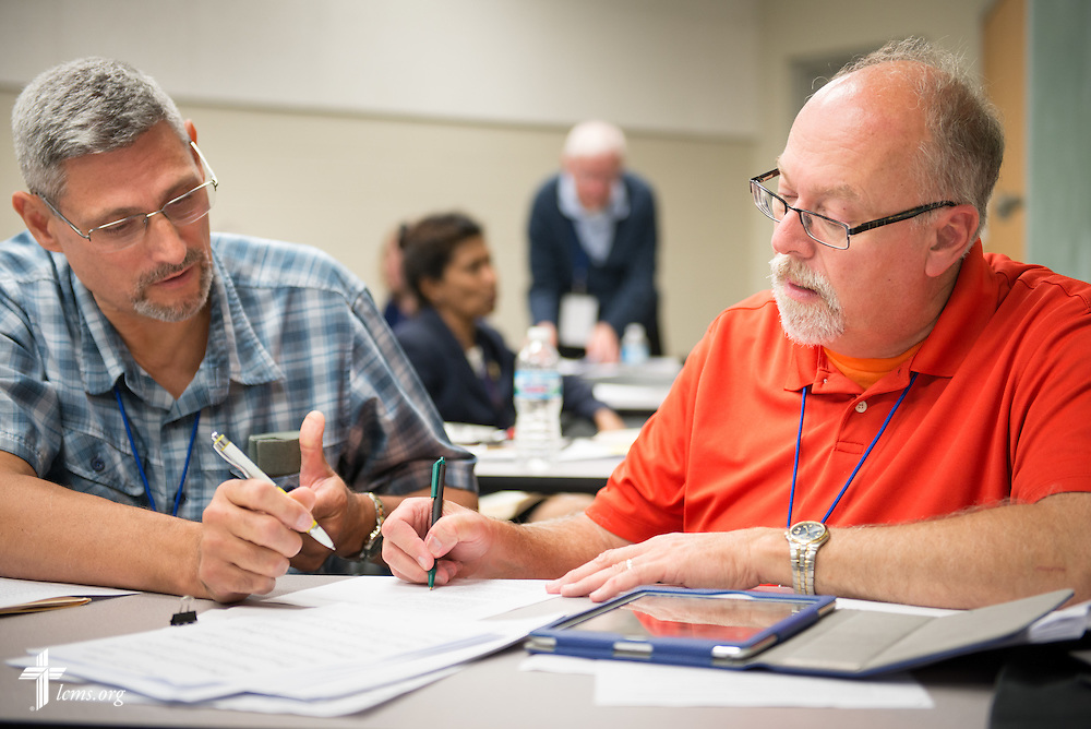 The Rev. Stephen Starke (right), pastor of St. John Lutheran Church (Amelith) in Bay City, Mich., helps Joel Shoemaker with hymn writing during a workshop at the 2014 Institute on Liturgy, Preaching and Church Music on Tuesday, July 29, 2014, at Concordia University, Nebraska, in Seward, Neb. LCMS Communications/Erik M. Lunsford