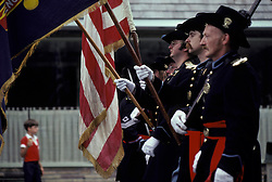 Americana Color guard of civil war reenactors march in small town holiday celebration parade.