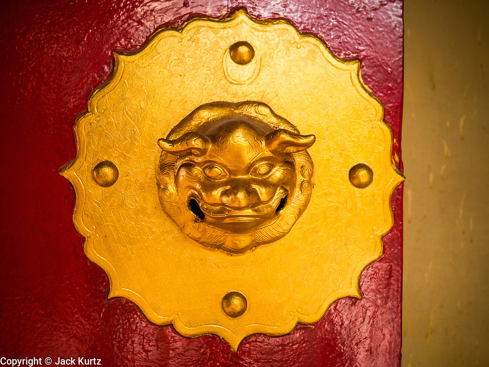 20 DECEMBER 2012 - KUALA LUMPUR, MALAYSIA:  A door handle leading into the Guan Di Temple in Kuala Lumpur, Malaysia. Guan Di Temple (God of War Temple) was built in 1888 and is one of the oldest Chinese Temples in Kuala Lumpur.  PHOTO BY JACK KURTZ