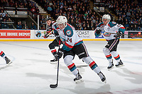 KELOWNA, CANADA - FEBRUARY 18: Erik Gardiner #12 and Kyle Topping #24 of the Kelowna Rockets skate up the ice against the Prince George Cougars on February 18, 2017 at Prospera Place in Kelowna, British Columbia, Canada.  (Photo by Marissa Baecker/Shoot the Breeze)  *** Local Caption ***