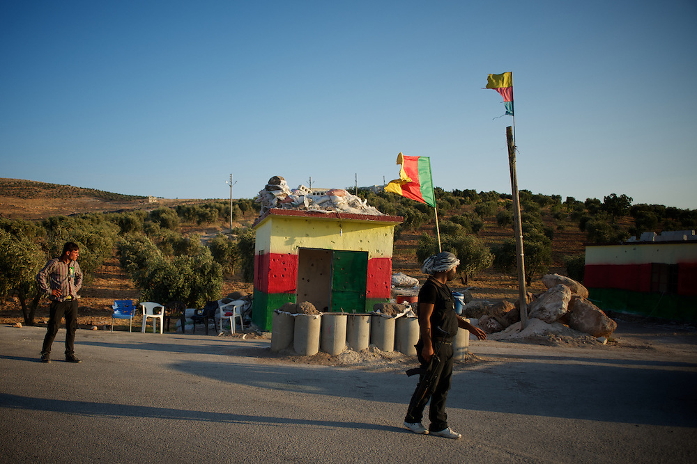 August 12, 2012 - Kafa Safra, Efrin, Syria: A group of Kurdistan Workers' Party (PKK) fighters take guard at a checkpoint outside the village of Kafra Safra...PKK has been fighting an armed struggle against the Turkish state for an autonomous Kurdistan and greater cultural and political rights for the Kurds in Turkey, Iraq, Syria and Iran. Founded on 27 November 1978 in the village of Fis, was led by Abdullah Öcalan. The PKK's ideology was originally a fusion of revolutionary socialism and Kurdish nationalism - although since his imprisonment, Öcalan has abandoned orthodox Marxism. The PKK is listed as a terrorist organization by Turkey, the United States, the European Union and NATO. (Paulo Nunes dos Santos)