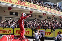 October 21, 2018 - Austin, TX, U.S. - AUSTIN, TX - OCTOBER 21: Ferrari driver Kimi Raikkonen (7) of Finland celebrates with fans and media after winning the F1 United States Grand Prix on October 21, 2018, at Circuit of the Americas in Austin, TX. (Photo by John Crouch/Icon Sportswire) (Credit Image: © John Crouch/Icon SMI via ZUMA Press)