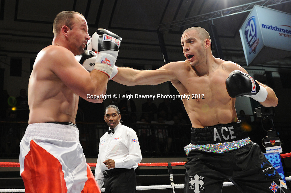 Andreas Evangelou (black shorts)  defeats Robert Studzinski in a 4x3min Light Heavyweight contest at York Hall, Bethnal Green, London on 28th January 2012.Matchroom Sport. © Leigh Dawney Photography 2012.