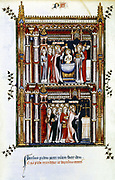 The Life of St Denis (Denys or Dionysius) written by a monk of the Abbey of St Denis. St Denis consecrates a church in Paris and baptises new Christians. St Denios, Apostle ot the Gauls and patron saint of France.14th century  Manuscript, Bibliotheque Nationale, Paris.