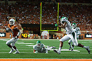 AUSTIN, TX - AUGUST 30:  John Harris #9 of the Texas Longhorns scores a 8 yard touchdown on a pass from David Ash against the North Texas Mean Green during the 3rd quarter on August 30, 2014 at Darrell K Royal-Texas Memorial Stadium in Austin, Texas.  (Photo by Cooper Neill/Getty Images) *** Local Caption *** John Harris