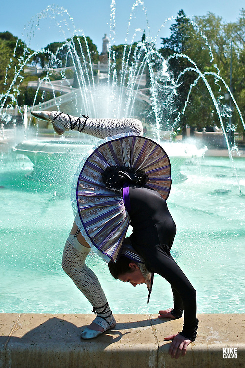 Spanish contorsionist and dancer Tania Cubero dressed in a tutu inspired in the traditional Aragonese Jotera dress at Jose Manuel Labordeta public park, previouly known as Parque Primo de Rivera