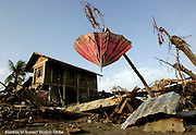 January 6, 2004 Banda Aceh, Indonesia--  An umbrella sits in a precarious perch among the remains of homes after the Dec. 26 tsunami wave which killed tens of thousands of people. photo by essdras m suarez/globe staff