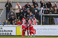 Ryan Row of Brackley Town (centre) celebrates scoring the opening goal against Lowestoft Town during the Conference North match at St. James Park, Brackley<br /> Picture by David Horn/Focus Images Ltd +44 7545 970036<br /> 24/01/2015