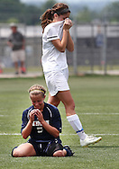 May 12, 2012; Huntsville, AL, USA;  Auburn's Addie Fargason (5) (on the ground) reacts after her team defeated Auburn for the 6A State Championships. Mandatory Credit: Marvin Gentry