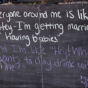 Blackboard humorous  outdoor restaurant sign.
