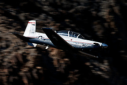 United States Air Force Beechcraft T-6 Texan II (01-599) from the 80th Flying Training Wing, Sheppard Air Force Base, Texas, flies low level through the Jedi Transition, Star Wars Canyon, Death Valley National Park, California, United States of America
