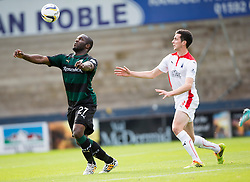 Raith Rovers Christian Nade and Falkirk's Joe Shaughnessy.<br /> half time : Raith Rovers 0 v 0 Falkirk, Scottish Championship game played 27/9/2014 at Raith Rovers Stark Park.