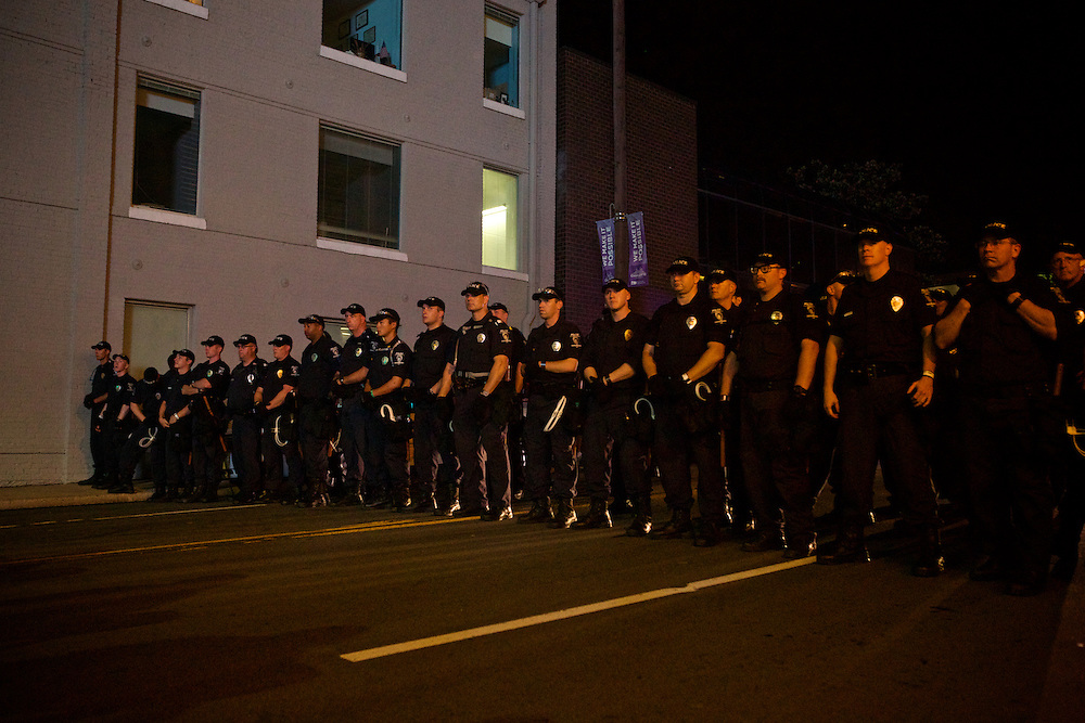 Law enforcement officers form a line across the street in order to block protesters from marching in that direction during the 2012 Democratic National Convention on Thursday, September 6, 2012 in Charlotte, NC.